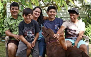 Kanoe Ahuna and her husband, Dan Ahuna, are seen here with their sons, from left to right, Kaiehu, Kaikea and Kilikai. Their furry family member, Chief, is also in the picture. Contributed photo