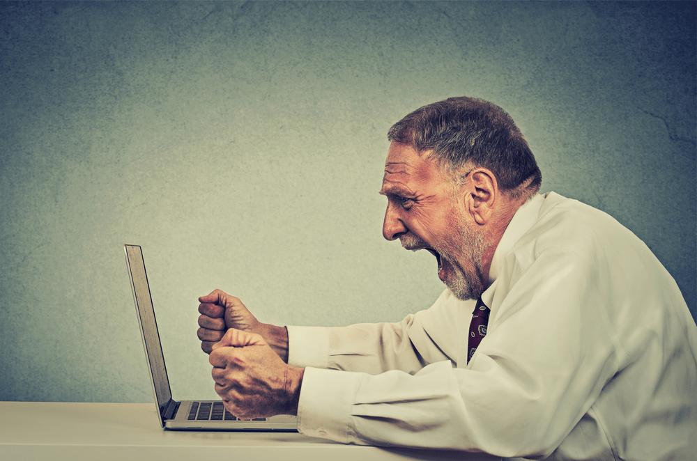 business man - screaming at laptop