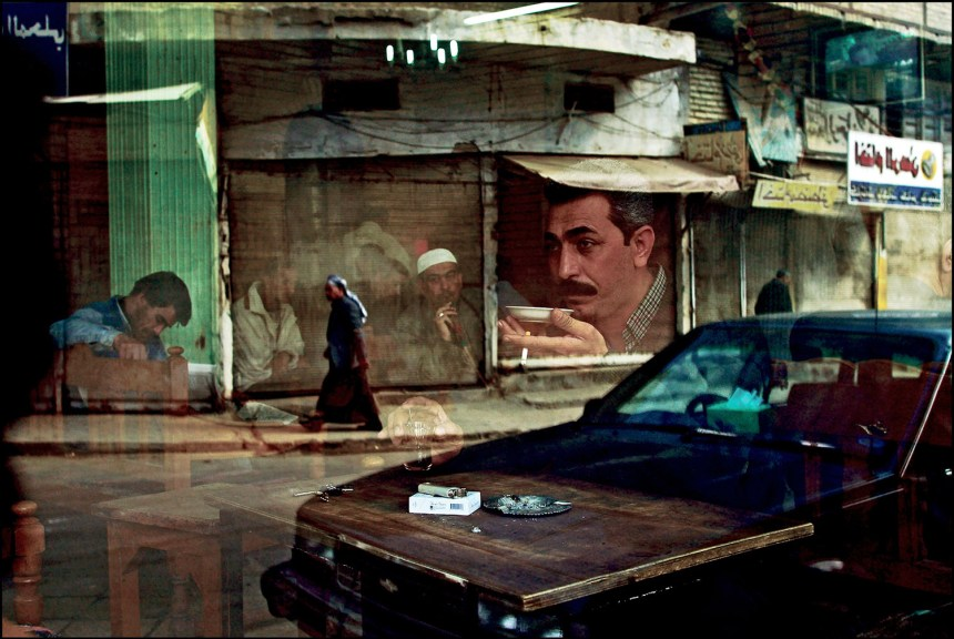 Baghdad February 12, 2003.  Six weeks before the start of the war, a man sits drinking tea at the Al Zahawi cafe on Rashid Street.  Cafes are a trademark of this ancient city, gathering places where men play dominos, blackjack and socialize.  Photo by Bruno Stevens