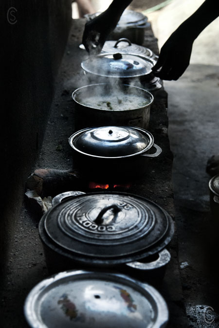 The kitchen in an outside courtyard. To suppliment the basic meals made in the jail some young people receive food supplys from their families. Often these are shared with those not as fortunate, in exchange for being allowed to help prepare meals.