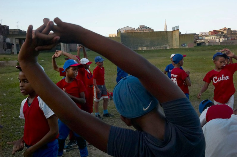 Baseball training at the Ponton in Centro Habana. Ponton is a public sport complex where kids come to train after school. Baseball is by far the most popular ball game in Cuba. Almost every boy plays baseball. November, 2013