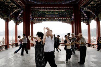 Beijing, People dance in Beihai Park.