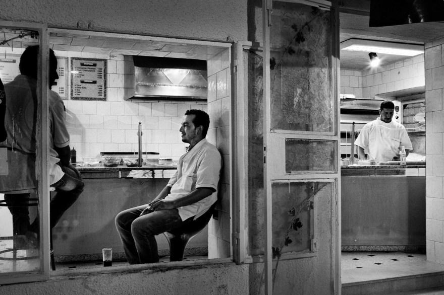 Men sit at the restaurant in Kairouan