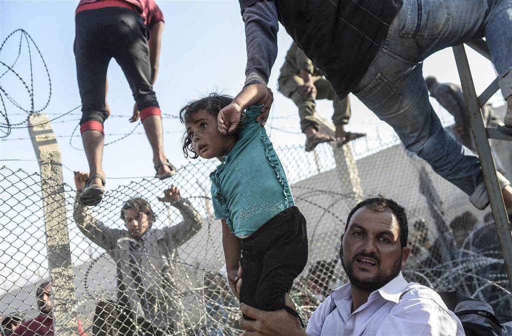12, Bulent Kilic, AFP - Getty Images, WPP via EPA, World Press Photo Awards Top Images of 2015