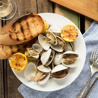 Learn how to make this simple recipe for Beer Steamed Clams - so easy you can even make them on the campfire! Includes instructions for cooking at home or on the campfire.