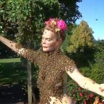 Topless woman dances with bees