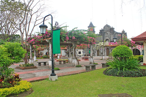 Nayong Pilipino garden with the replica of Barasoain Church in the background