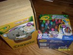 Box of Crayola crayon pads and Crayola telescoping marker tower
