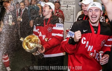 PRAGUE, CZECH REPUBLIC - MAY 17: Canada's Sidney Crosby #87, Nathan Mackinnon #29, Matt Duchene #9 and Jake Muzzin #6 celebrating with teammates after a 6-1 gold medal game win over Russia at the 2015 IIHF Ice Hockey World Championship. (Photo by Andre Ringuette/HHOF-IIHF Images)