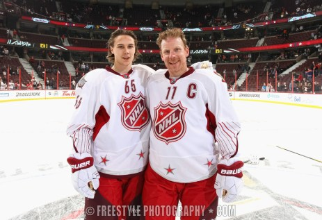 OTTAWA, ON - JANUARY 29: Erik Karlsson #65 (L) and Daniel Alfredsson #11 of the Ottawa Senators and team Alfredsson pose on the ice after the 2012 Tim Hortons NHL All-Star Game at Scotiabank Place on January 29, 2012 in Ottawa, Ontario, Canada. Team Chara won the game 12-9. (Photo by Andre Ringuette/NHLI via Getty Images)