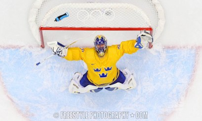 SOCHI, RUSSIA - FEBRUARY 21: Sweden's Henrik Lundqvist #30 looks up and celebrates his victory against Finland during men's semifinals round action at the Sochi 2014 Olympic Winter Games. (Photo by Andre Ringuette/HHOF-IIHF Images)