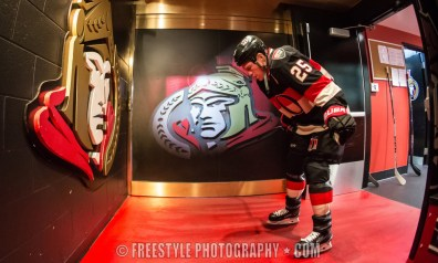 OTTAWA, ON - OCTOBER 22: Prior to playing in his 900th career NHL game, Chris Neil #25 of the Ottawa Senators stands alone outside the locker room before taking warmup before playing against the New Jersey Devils at Canadian Tire Centre on October 22, 2015 in Ottawa, Ontario, Canada. (Photo by Andre Ringuette/NHLI via Getty Images)