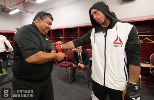 OTTAWA, ON - JUNE 18: Donald Cerrone gets his gloves taped backstage before the UFC Fight Night event inside the TD Place Arena on June 18, 2016 in Ottawa, Ontario, Canada. (Photo by Andre Ringuette/Zuffa LLC/Zuffa LLC via Getty Images)