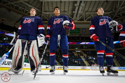 USA's Jake Oettinger #30, Kieffer Bellows #22, James Greenway #14 enjoy their national anthem after a 12-1 victory over Latvia during preliminary round action at the 2016 IIHF Ice Hockey U18 World Championship. (Photo by Matt Zambonin/HHOF-IIHF Images)