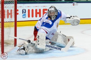 Russia's Danil Tarasov #1 makes a save against Sweden in the second period during preliminary round action at the 2016 IIHF Ice Hockey U18 World Championship. (Photo by Matt Zambonin/HHOF-IIHF Images)