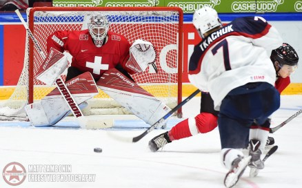 USA's Matthew Tkachuk #7 fires a shot on Switzerland's Ludovic Waeber #1 during preliminary round action at the 2016 IIHF World Junior Championship. (Photo by Matt Zambonin/HHOF-IIHF Images)