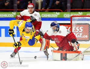 Sweden's Joel Eriksson Ek #20 dives after the puck in front of Denmark's Thomas Lillie #31 during preliminary round action at the 2016 IIHF World Junior Championship. (Photo by Matt Zambonin/HHOF-IIHF Images)