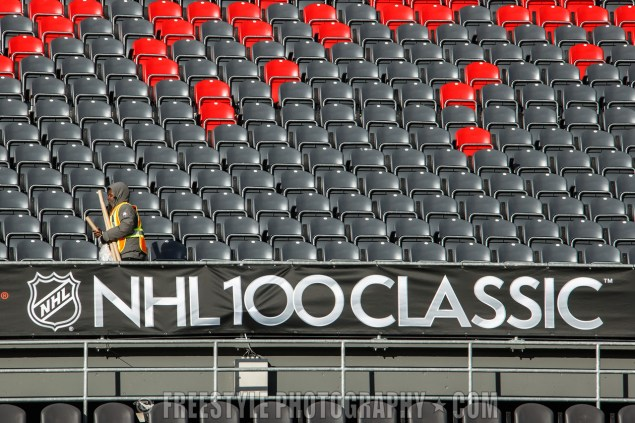 OTTAWA, ON - DECEMBER 8: A worker installs signage ahead of the Scotiabank NHL100 Classic at Lansdowne Park on December 8, 2017 in Ottawa, Canada. (Photo by Andre Ringuette/NHLI via Getty Images)