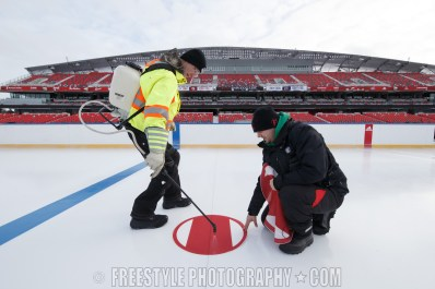 OTTAWA, ON - DECEMBER 10: Members of the ice crew install a face-off dot in the ice ahead of the Scotiabank NHL100 Classic between the Ottawa Senators and the Montreal Canadiens, at Lansdowne Park on December 10, 2017 in Ottawa, Canada. (Photo by Andre Ringuette/NHLI via Getty Images)