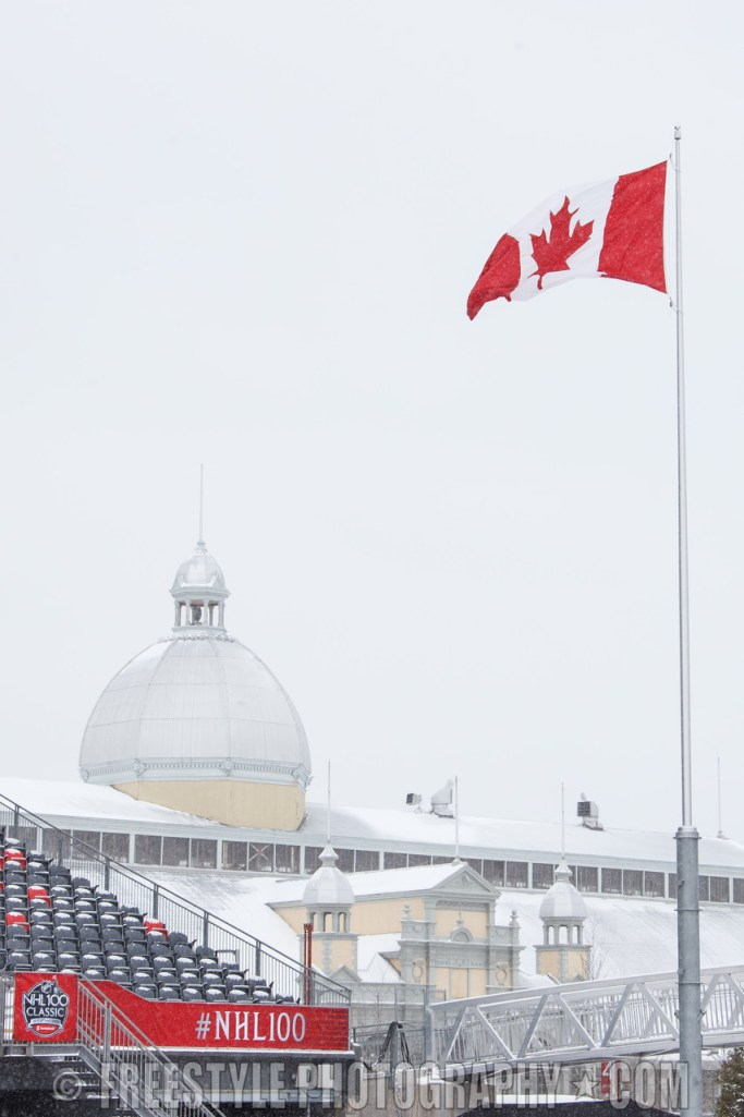 OTTAWA, ON - DECEMBER 12: A Canadian flag flies in the wind with Aberdeen Pavilion in the background ahead of the Scotiabank NHL100 Classic between the Ottawa Senators and the Montreal Canadiens, at Lansdowne Park on December 12, 2017 in Ottawa, Canada. (Photo by Andre Ringuette/NHLI via Getty Images)