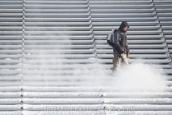 OTTAWA, ON - DECEMBER 13: A worker clears snow from the bleachers ahead of the Scotiabank NHL100 Classic between the Ottawa Senators and the Montreal Canadiens, at Lansdowne Park on December 13, 2017 in Ottawa, Canada. (Photo by Andre Ringuette/NHLI via Getty Images)
