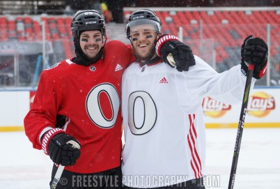 OTTAWA, ON - DECEMBER 15: Erik Karlsson #65 and Fredrik Claesson #33 of the Ottawa Senators pose for a photo during a practice session ahead of the Scotiabank NHL100 Classic, at Lansdowne Park on December 15, 2017 in Ottawa, Canada. (Photo by Andre Ringuette/NHLI via Getty Images)