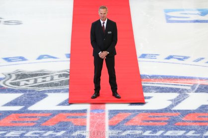 PRAGUE, CZECH REPUBLIC - OCTOBER 4: Dominik Hasek shakes stands at center ice before a ceremonial face-off prior to the Global Series Challenge game between the Philadelphia Flyers and Chicago Blackhawks at O2 Arena on October 4, 2019 in Prague, Czech Republic. (Photo by Andre Ringuette/NHLI via Getty Images)