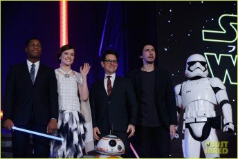 TOKYO, JAPAN - DECEMBER 10: (from left) John Boyega, Daisy Ridley, J.J. Abrams, BB-8, Adam Driver and Stormtrooper attend the'Star Wars: The Force Awakens' fan event at the Roppongi Hills on December 10, 2015 in Tokyo, Japan. (Photo by Christopher Jue/Getty Images for Walt Disney Studios)