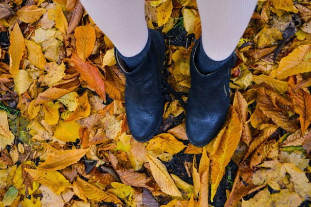 Black boots autumn leaves