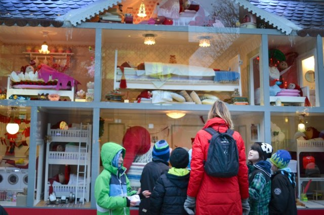 children looking at Christmas window display