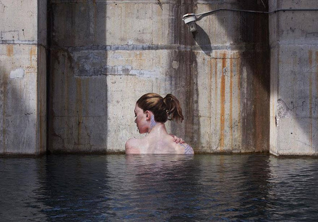Sean yoro painting mural ladies back