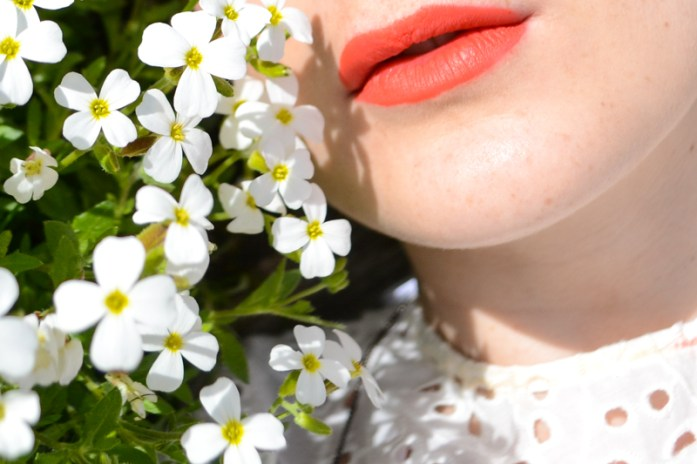 Florals and cotton eyelets, red lips