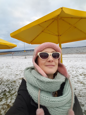 Wrapped up warm on snowy beach