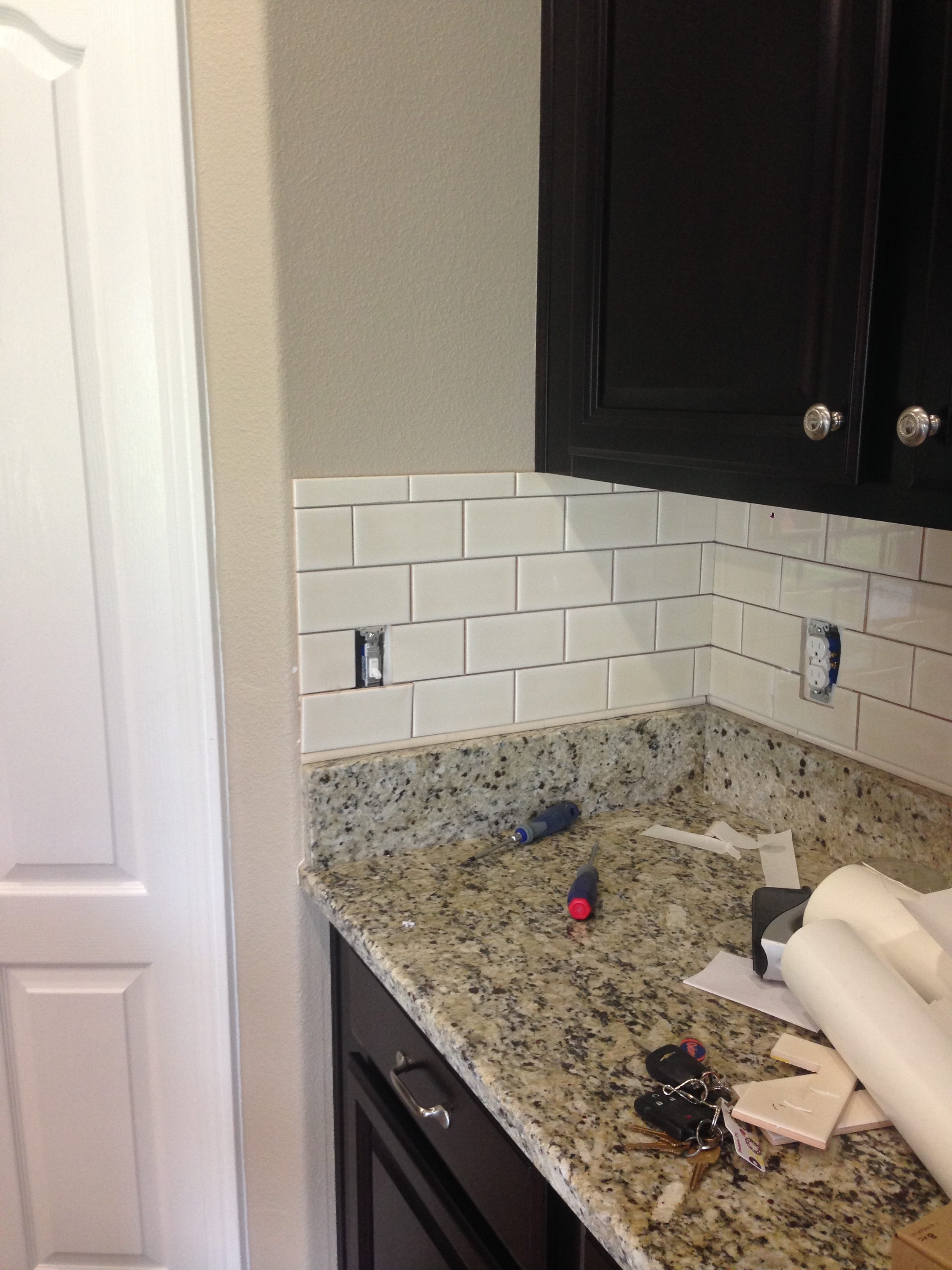 diy kitchen backsplash frills drills the only other part of backsplash to complete was this tiny section on the left side of our refrigerator it was difficult with quite a few cuts due to the