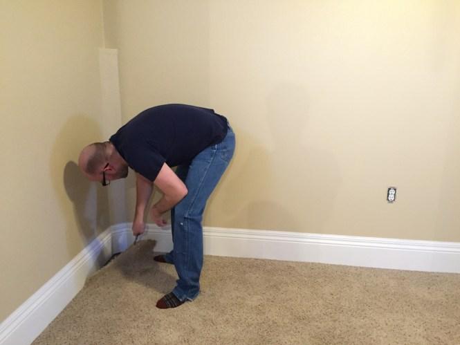 Jesse pulling up carpet