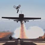 Dirtbike_Backflips_over_Aerobatic_Plane_16