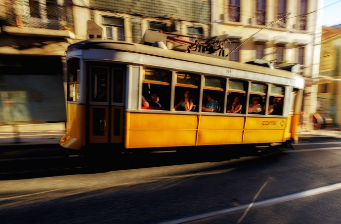 Panning shot of a passing tram in Lisbon. Processed RAW files using Lightroom's Velvia film simulation.