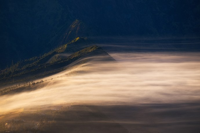 First light across the mist in the the caldera at Mount Bromo, Indonesia.  Fuji X-T10 & XF55-200mm