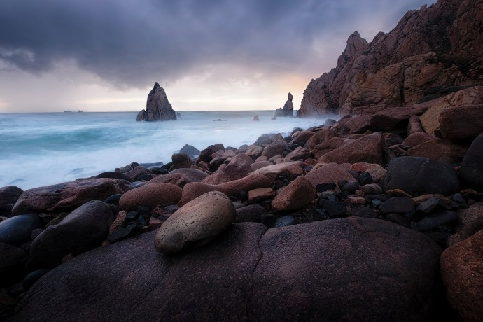 "The rocky beach at Praia da Aroeira Fuji X-T1 . Fuji XF10-24mmF4 @ 10mm . f/8 . 2.5"" . ISO 200"