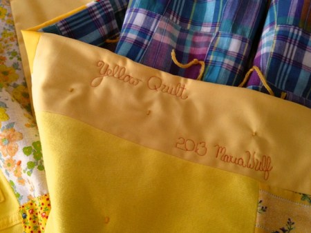 yellow quilt signed  104