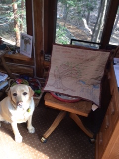 "My wall hanging, ""Piper in the Wind"" in it's new home with Maureen (and her dog)."