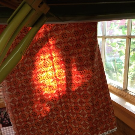 The sun shining through some fabric in my studio