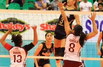 NU's Jaja Santiago (3) towers over Katherine Bersola and Justine Dorog of UP as she goes for a hit during their Shakey's V-League Collegiate Conference encounter at the Philsports Arena.