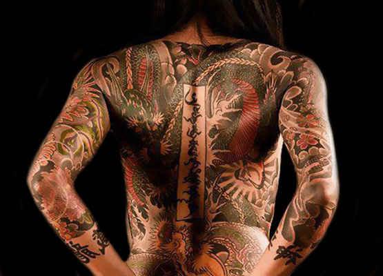 Full body back tattoo on girls