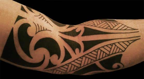 Arm with tribal tattoo motif