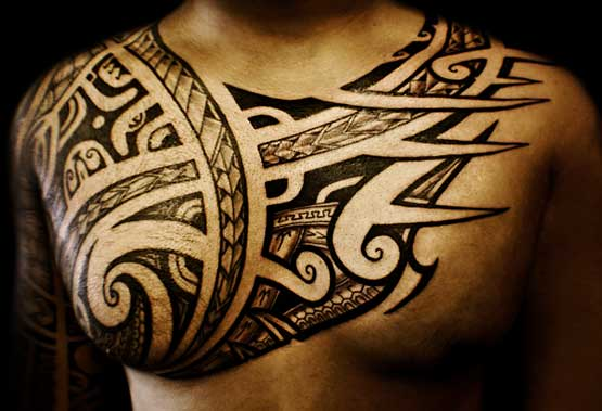Muscle tribal tattoo design