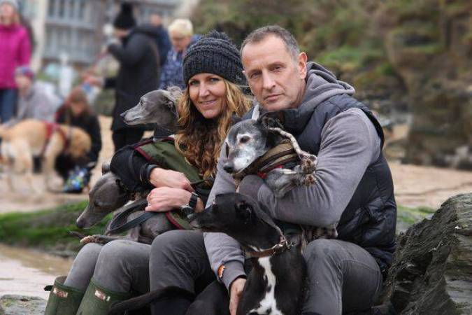 Hundreds of dog lovers turn out on a rainy day to share Walnut the dog's last walk, Newquay