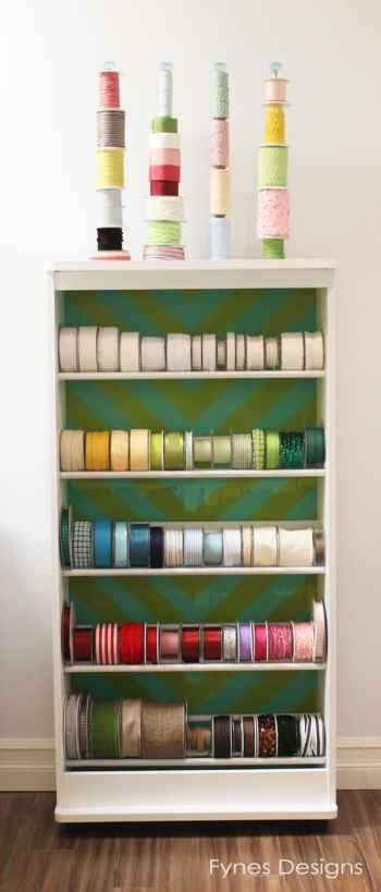 Ribbon storage idea from an old VHS rack