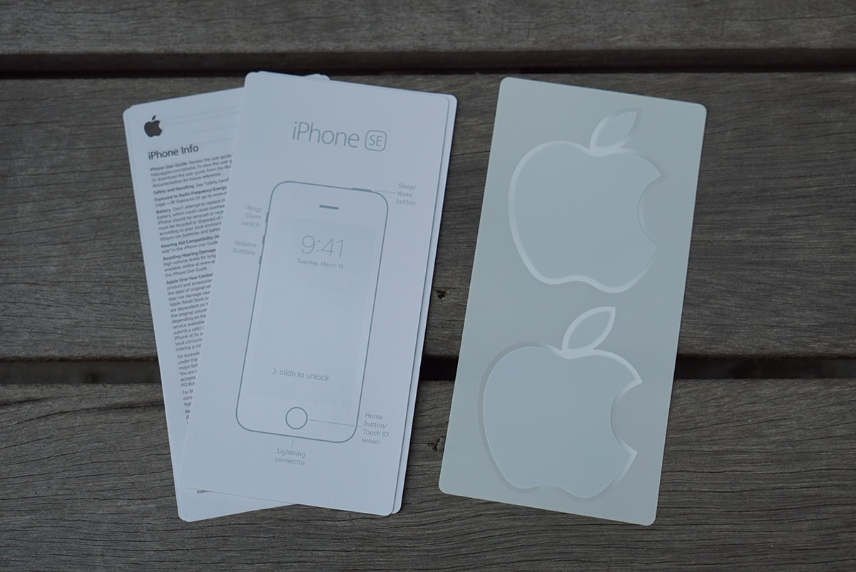 User manuals and Apple logo stickers