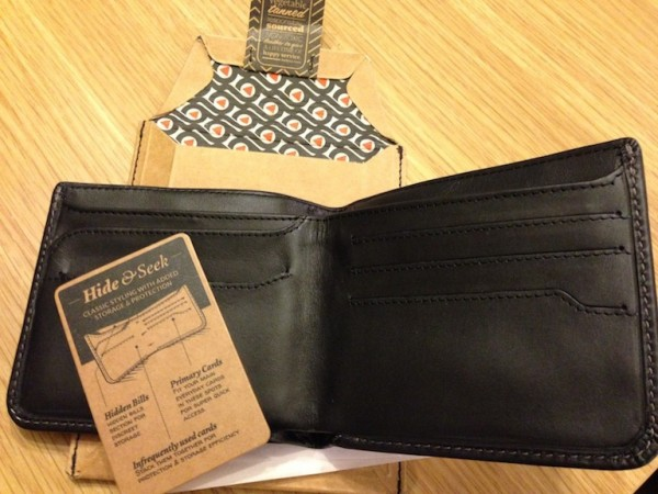 Once opened you are welcomed with a card, ultra cool packaging and your brand new wallet.